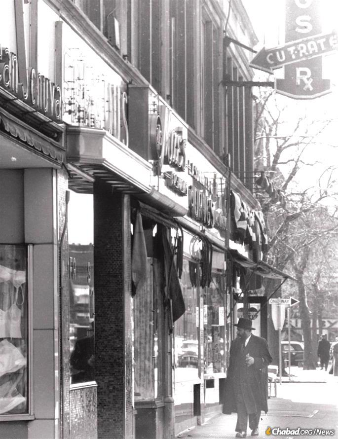 A religious Jew walks up Utica Avenue, looking north toward Eastern Parkway, circa 1958. Utica was once the main Jewish shopping drag in the area. (Credit: Brian Merlis Collection / oldNYCphotos.com)
