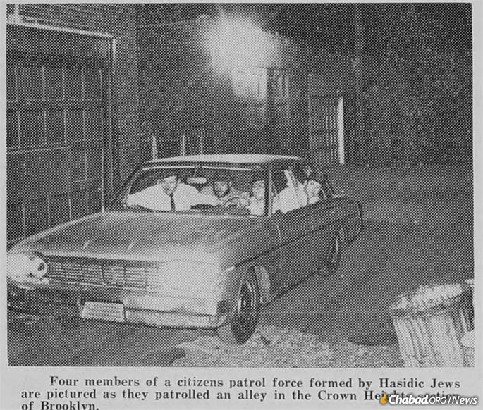 Members of the Maccabees community patrol in a Crown Heights alley circa 1964. The Maccabees were the brainchild of Rabbi Samuel Schrage, and brought attention to the plight of law-abiding citizens under attack without police protection, and helped make the neighborhood safer.
