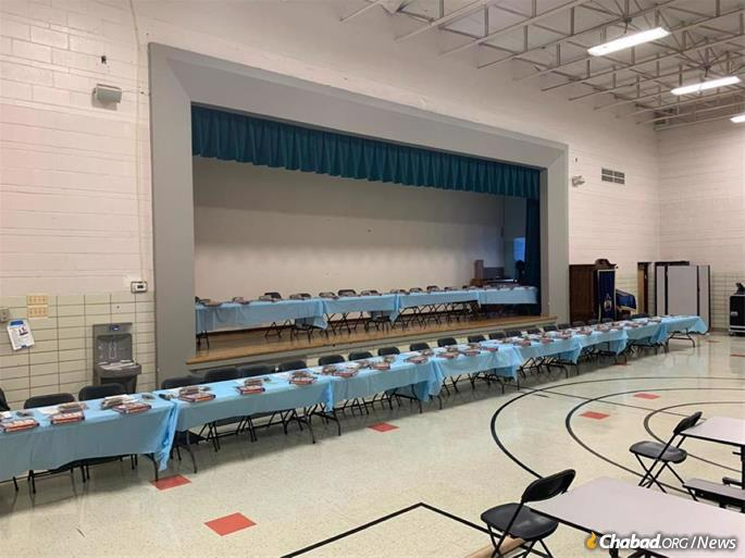 The tables were set for nearly 40 little boys and their fathers.