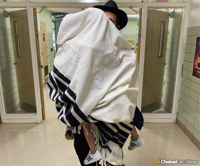 Each boy was brought into the school building wrapped in a tallit, shielded from anything impure.