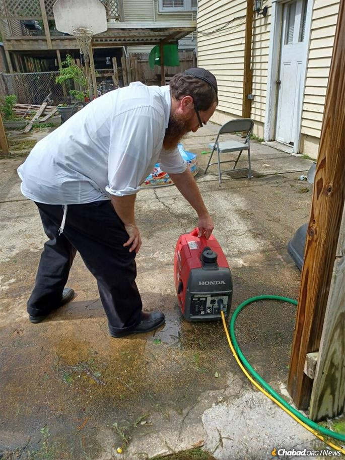 Rabbi Mendel Rivkin sets up a small generator outside his Chabad House in New Orleans.