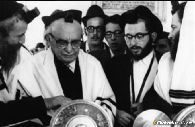 On his wedding day at the Torah reading, alongside Israeli President Zalman Shazar, to whom he had been dispatched by the Rebbe as his personal agent.