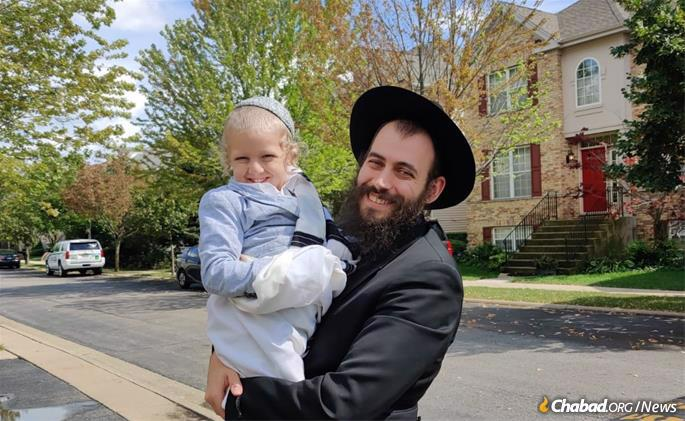 Ze'ev and Levi Yitzchak Shkolnikov outside their Chicago home.