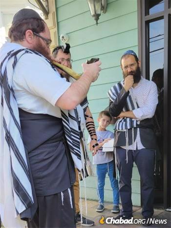 Services were held outdoors in New Orleans, where Rabbi Mendel Rivkin blew the shofar as is customary in the month before Rosh Hashanah.