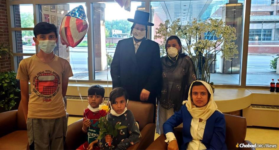 Rabbi Moshe Margaretten helped bring the children of this Afghan woman to safety.