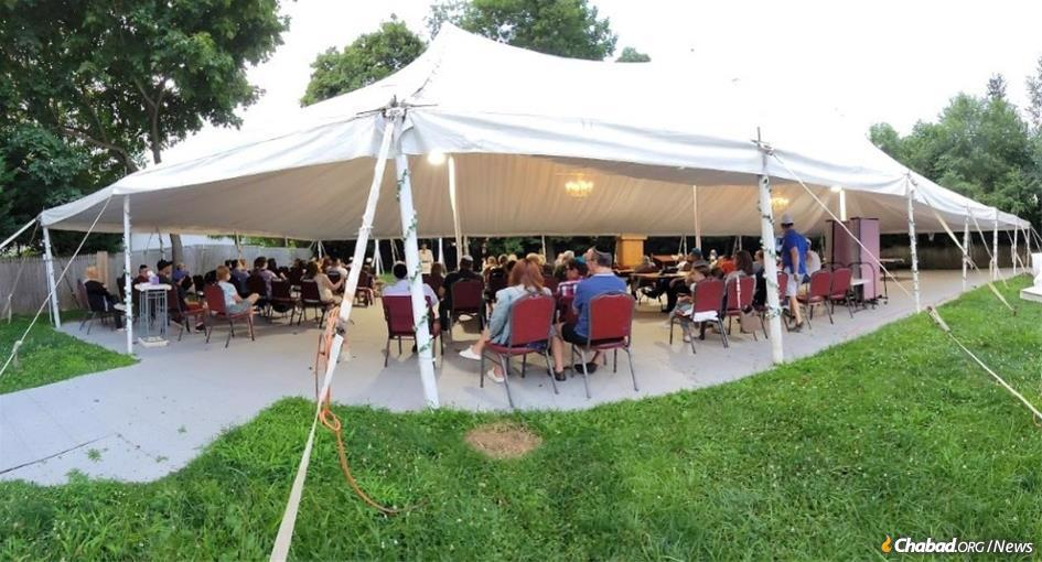 At Chabad of Hewlett, N.Y., Rosh Hashanah services will take place in a roofed open-air space, seen here during a recent community gathering.
