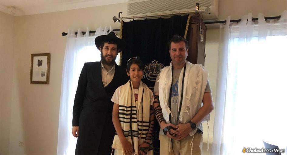 Daniel Azoulay, center, with Rabbi Ari Rubin, and the bar mitzvah boy's dad, Eyal Azoulay.