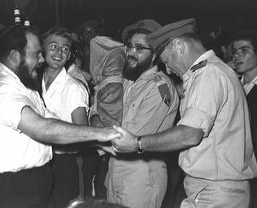 Yitzhak Rabin, chief of staff of the Israel Defense Force (IDF), dances with Chabadniks at a Simchat Torah celebration. Following the Sukkot holiday, Chabadniks visited an IDF army base to celebrate with the soldiers.   Photo: Milner Moshe/Israeli National Photo Library