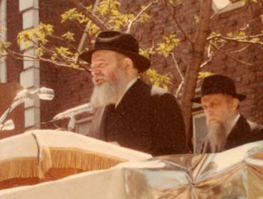 The Lubavitcher Rebbe, Rabbi Menachem Mendel Schneerson of righteous memory, addresses the crowd at a Unity Parade in Brooklyn.