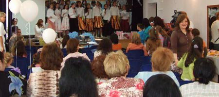 The bat mitzvah girls celebrate their accomplishment in a presentation to their parents and guests.