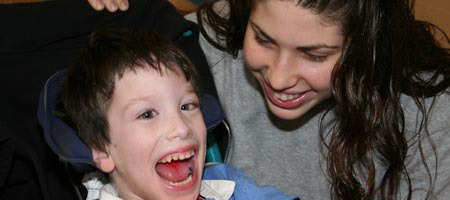 A volunteer places a smile on the face of her special friend at the Friendship Circle of Livingston, New Jersey