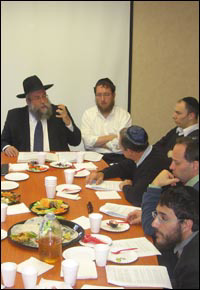 Rabbi Yisroel Deren, regional director of Chabad-Lubavitch of Fairfield County in Connecticut, gives a guest lecture to the weekly Maimonides class at Chabad-Lubavitch of Cape Town, South Africa.