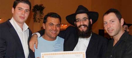 A newly minted rabbi in Antwerp, Belgium, celebrates with community members.