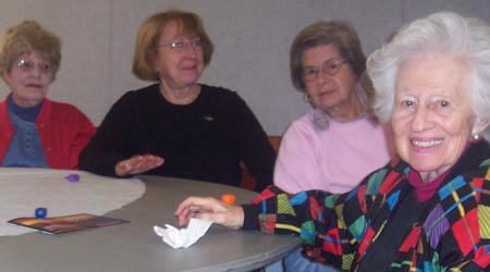 A group of seniors share a lovely afternoon at the Schmooze Club.