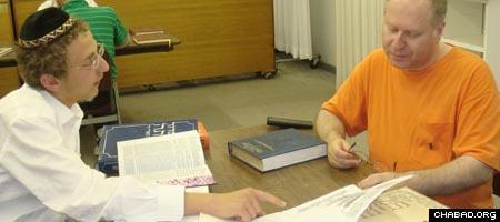 Martin Glazer, a lawyer, and Avrohom Wolf study Torah at the Lubavitch Centre of Winnipeg, Canada.