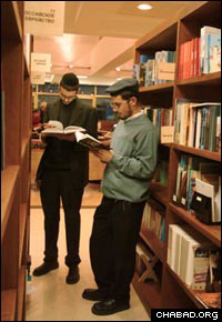 Students from the Tomchei Tmimim Lubavitch yeshiva in Moscow do research in the library at the Marina Roshtza Jewish Community Center.