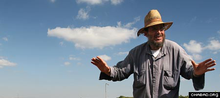 Nachum Luria stands near his orchard in Kfar Chabad, Israel. (Photo: Y. Belinko)