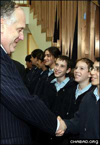 Ronald S. Lauder greets students at the Lauder Chabad school in Vienna during a ceremony celebrating the school's 20th anniversary and the opening of a new floor at the campus.