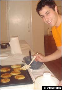A University of Maryland student makes pancakes at the Bais Menachem Chabad Jewish Student Center in College Park, Md.