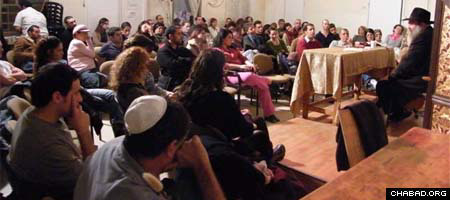 Rabbi Yair Kalev presides over his weekly class in Tel Aviv.