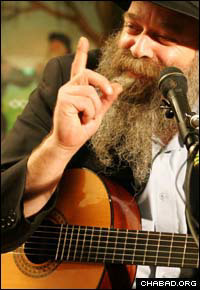 Rabbi Yair Kalev clutches his guitar during a lecture in Sydney, Australia.
