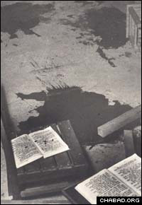 Pictures of blood-soaked holy books in the wake of Thursday night's slaughter of eight students at Jerusalem's Mercaz Harav yeshiva brought back memories of a similar attack 52 years ago in the central Israeli village of Kfar Chabad, when five schoolchildren were murdered during their morning prayers. (File photo Kfar Chabad, 1956)