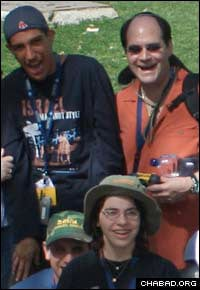 A young adult with special needs, left, and a volunteer enjoy a trip through the Holy Land.