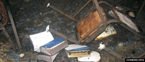 A few charred books and pieces of furniture are all that remains of the interior of the Chabad House in Miami Beach after a suspected arson.