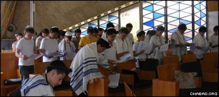 Middle school students from Be'er Sheva, Israel, take part in a joint bar mitzvah organized by the city's Chabad-Lubavitch Center.