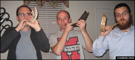 Baltimore residents Joshua Wnuk, Ron Reitman and Rabbi Levi Druk practice blowing shofars in advance of the holiday of Rosh Hashanah.