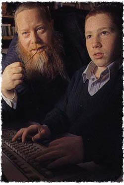 YY Kazen (left) with his son Michoel Kazen work together on Chabad.org (Photo: Andy Levin/24 Hours in Cyberspace)