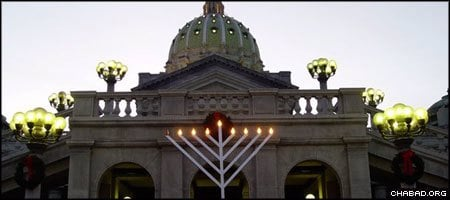 A Chanukah menorah placed by Chabad-Lubavitch shines bright at the Pennsylvania State Capitol in Harrisburg. (Photo: L.M. Sweger)