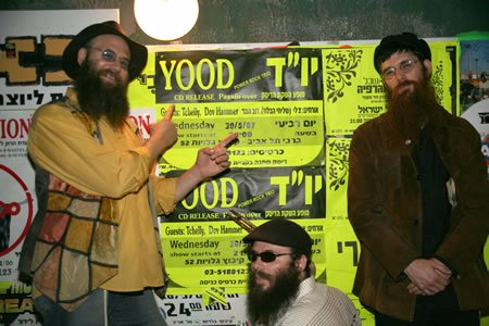 Next to a poster advertising the release of their new CD