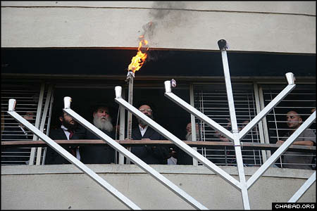 The evening events began with the lighting of a restored 25-foot steel menorah outside of the city's Chabad House, where directors Rabbi Gavriel and Rivka Holtzberg and four other Jewish people were murdered. (Photos: Meir Alfasi)