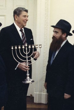 President Ronald Reagan receives a Menorah from a delegation of Chabad-Lubavitch emissaries