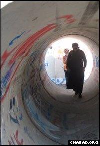 Walking through the makeshift shelter outside Rabbi Yigal Kirschenshaft's home