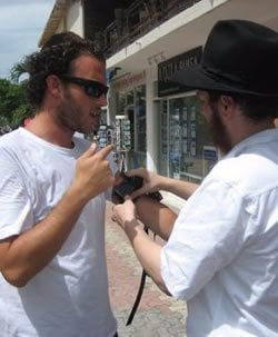 Rabbi Druk helps a tourist put on Tefillin
