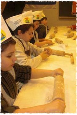 Kids in Darmstadt, Germany, make their own mock matzah bread with Rabbi Mendel Gurewitz.