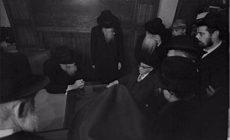 The Rebbe, prior to a private audience with former Israeli President Zalman Shazar, introduces him to Chabad-Lubavitch emissaries from across the globe. © 2009 JERRY DANTZIC ARCHIVES, All Rights Reserved