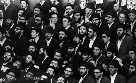The crowd assembled at the farbrengen joined in chassidic melody. © 2009 JERRY DANTZIC ARCHIVES, All Rights Reserved