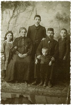 Rabbi Avraham Eleh Plotkin, center standing, recorded this story. Sitting in the center are his parents, Chaya Rasyah (left) and Shmuel. Rabbi Plotkin, who passed away in 1949, was a renowned chassid and leader of the Chabad underground in the USSR.