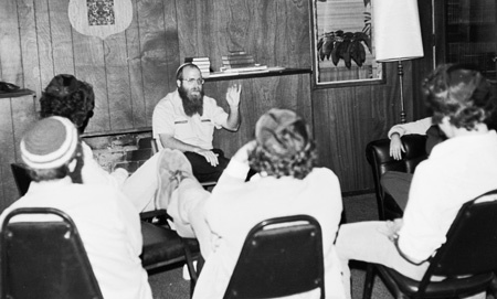 Students sit around the fireplace at the Chabad House at the UCLA campus in Westwood, California.