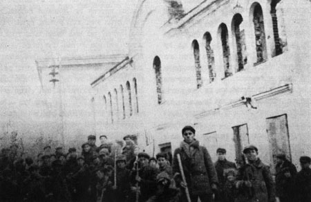 Local Jews are forced to stand and pose as they cleaned the burnt-down study hall, where many of the local Jewish leaders were burnt alive on the day the Germans arrived in the town.