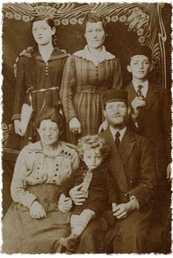 Chaim Meir Bukiet on his father Avraham Shmuel's lap. Sitting next to him is Avraham Shmuel's mother, Chaya. In the center of the top row is Chaim Meir's mother, Rochel; on her right is Avraham Shmuel's sister, Feigah; and on her left is his brother, Yisroel. Everyone in the picture besides Chaim Meir was murdered by the Nazis.