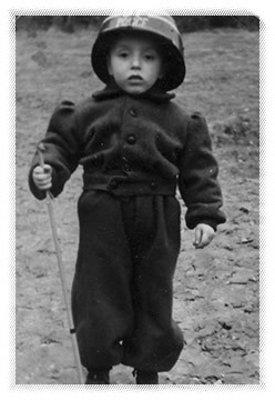 Moshe Winter wearing an outfit his father sewed from blankets.