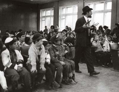 Following the fall of communism Rabbi Berel Lazar discusses Judaism with local Moscow youth