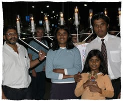 Dr. Abraham and his children at the Chanukah celebration in Mumbai.