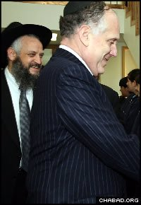Austrian Rabbi Dov Gruzman, left, who was attacked Saturday night, gave former U.S. Ambassador Ronald S. Lauder a tour of the high school bearing his name last year.