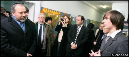 Israeli Foreign Minister Avigdor Lieberman listens to a student representative's presentation at the Simcha School in Kiev.