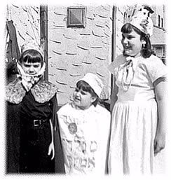 The author (left) and her sisters celebrate Purim in simpler times.